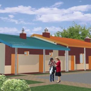 Mieszkania socjalne w kolorowych szeregówkach z gankiem