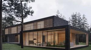 Dom Leśny nawiązuje do ciemnych pni sosen