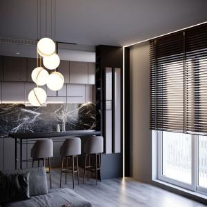 Tak urządzono małe mieszkanie w monochromatycznych odcieniach szarości